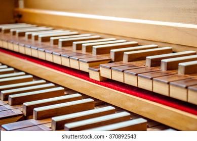 Harpsichord keyboard focus on one note