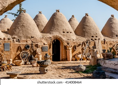 HARRAN, TURKEY - SEPTEMBER 27 2012: Traditional mud brick buildings topped with domed roofs and constructed from mud and salvaged brick.