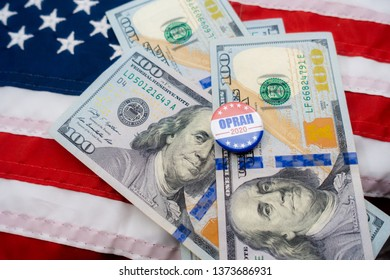Harrisburg, PA - April 18, 2019 - Oprah 2020 presidential  campaign badge surrounded by background of $100 bills and the US flag. Selective focus shallow depth of field - image