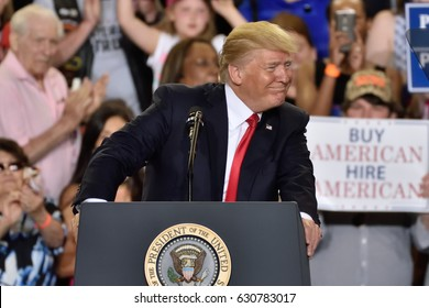 HARRISBURG, PA - APRIL 29, 2017: President Donald Trump leaning right face smile during a campaign rally to mark 100 days in office. Held at The Farm Show Complex and Expo Center.