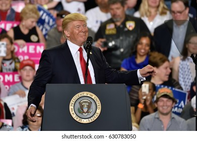 "HARRISBURG, PA - APRIL 29, 2017: President Donald Trump delivers a speech to mark ""100 days""  in office at a post election campaign rally. Held at The Farm Show Complex and Expo Center."