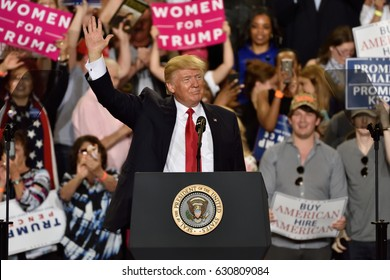 HARRISBURG, PA - APRIL 29, 2017: President Trump waves to supporters at a campaign rally to mark 100 days in office. Held at The Farm Show Complex and Expo Center.