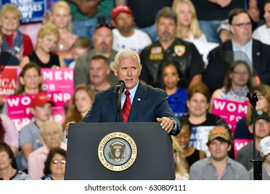 HARRISBURG, PA - APRIL 29, 2017: Vice President Mike Pence delivers a speech at a Trump campaign rally marking 100 days in office. Held at The Farm Show Complex and Expo Center.