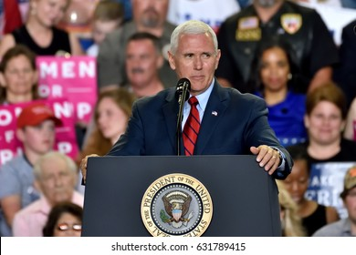 HARRISBURG, PA - APRIL 29, 2017: Vice President Mike Pence speaks to supporters at a Trump campaign rally marking 100 days in office at the Farm Show Complex and Expo Center.