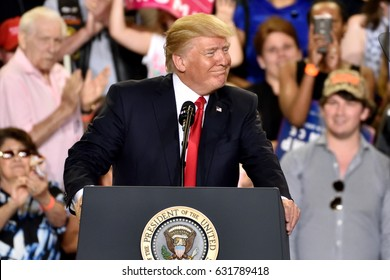 HARRISBURG, PA - APRIL 29, 2017: President Donald Trump right face smile during a campaign rally to mark 100 days in office. Held at The Farm Show Complex and Expo Center.