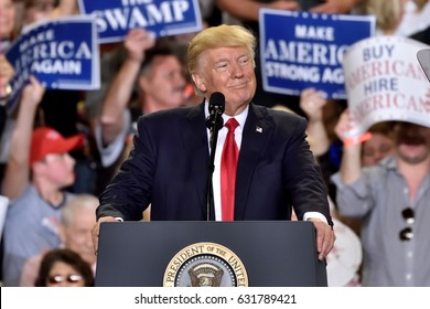 HARRISBURG, PA - APRIL 29, 2017: President Donald Trump pauses during a campaign rally to mark 100 days in office. Held at The Farm Show Complex and Expo Center.