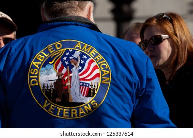 "HARRISBURG, PA - JANUARY 19: An unidentified women talks to a disabled American veteran before the ""Guns Across America""� rally at the Pennsylvania State Capitol on January 19, 2013 in Harrisburg, PA."