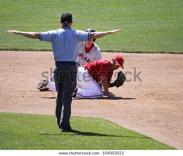 HARRISBURG, PA - MAY 31:The umpire signals safe fora  Portland Seadogs' runner at second base against the Harrisburg Senators  at Metro Bank Park on May 31, 2012 in Harrisburg, PA.