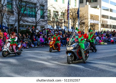 Harrisburg, PA - November 21, 2015: Elves on scooters on the downtown street in the City of Harrisburg during the annual Holiday Parade.