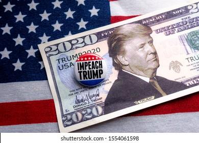 Harrisburg, PA - November 8, 2019 : Impeach Trump badge against Donald Trump 2020 Re-Election Presidential Dollar Bill.