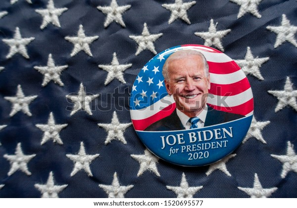 Harrisburg, PA - October 2, 2019 - Joe Biden campaign button against a United States of America flag. Selective focus and depth of field.