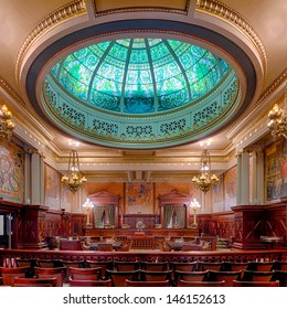 HARRISBURG, PENNSYLVANIA - JULY 5: Stained glass green dome in the Supreme Court Chamber in the Pennsylvania State Capitol building on July 5 in Harrisburg, Pennsylvania