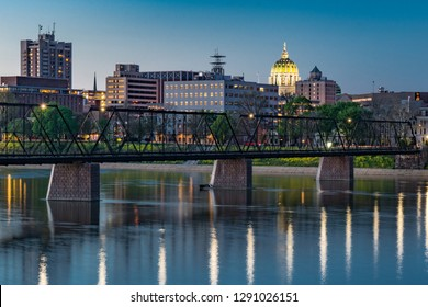Harrisburg, Pennsylvania night skyline from the Market Street bridge with state capitol dome in the background.