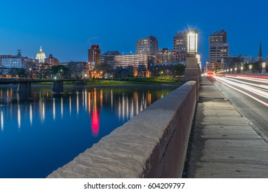 Harrisburg, Pennsylvania night skyline from the Market Street bridge with state capitol .