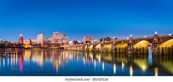 Harrisburg, Pennsylvania skyline with the historic Market Street Bridge reflected on the Susquehanna River at dusk