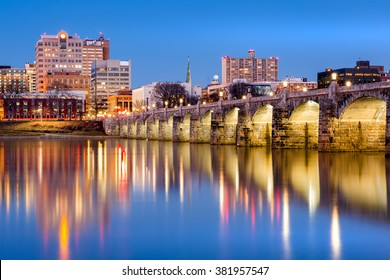 Harrisburg, Pennsylvania skyline with the historic Market Street Bridge reflected on the Susquehanna River at dusk