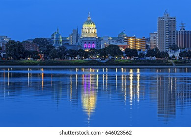 Harrisburg Pennsylvania skyline with State Capital Building. Nighttime view from across the Susquehanna River.