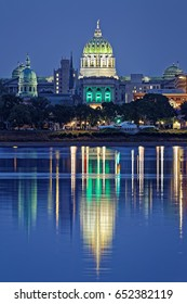 Harrisburg Pennsylvania skyline with State Capital Building. Tents are set up in the park for Memorial Day festivities. The view is from across the Susquehanna River.