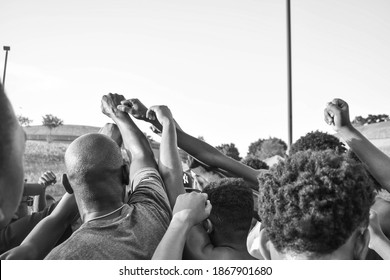 Harrisburg, Pennsylvania United States of America - July 10th 2019: a volunteer coach motivates his team of inner city youth before they begin a scrimmage game