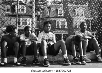 Harrisburg, Pennsylvania United States of America - July 10th 2019: inner-city youth sit down in preparation to hear their coach's instructions before practice