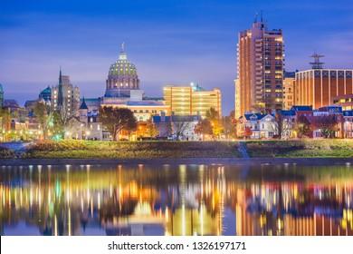 Harrisburg, Pennsylvania, USA downtown city skyline on the Susquehanna River in the evening.