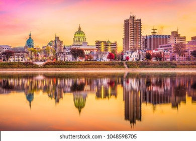 Harrisburg, Pennsylvania, USA downtown skyline on the Susquehanna River at dusk.