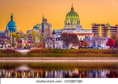 Harrisburg, Pennsylvania, USA downtown skyline on the Susquehanna River at dusk during fall.