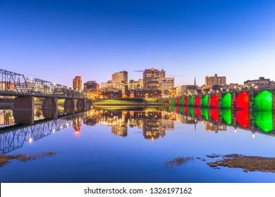 Harrisburg, Pennsylvania, USA skyline on the Susquehanna River at night.