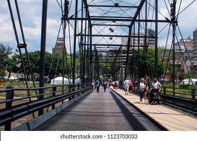 Harrisburg, Pennsylvania/USA - May 26, 2018: Pedestrians Crossing Walnut Street Truss Bridge Downtown to City Island