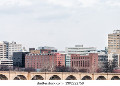 Harrisburg, USA - April 6, 2018: Cityscape skyline and bridge in Pennsylvania capital city view from highway road on cloudy day