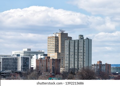 Harrisburg, USA - April 8, 2018: Cityscape skyline in Pennsylvania capital city view from highway road on cloudy day