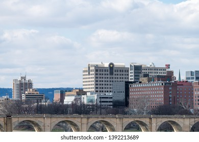Harrisburg, USA - April 8, 2018: Cityscape skyline in Pennsylvania capital city view from highway road on cloudy day over Susquehanna river