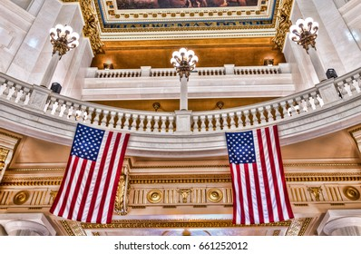 Harrisburg, USA - May 24, 2017: Pennsylvania capitol interior dome colorful ceiling in city with American Flags