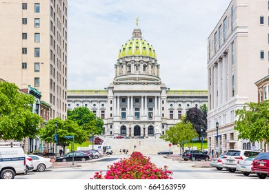 Harrisburg, USA - May 24, 2017: Pennsylvania capitol exterior in city with many red pink rose bushes and street