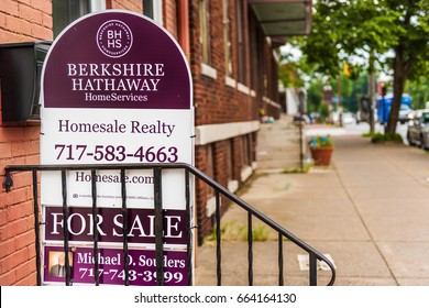 Harrisburg, USA - May 24, 2017: Pennsylvania capital city houses with Berkshire Hathaway for sale sign in downtown by sidewalk street