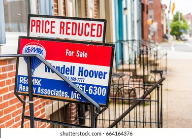 Harrisburg, USA - May 24, 2017: Pennsylvania capital city houses with Re Max for sale, price reduced sign in downtown by sidewalk street
