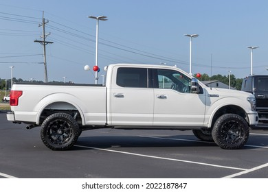 Harrison - Circa August 2021: Ford F-150 display at a dealership. The Ford F150 is available in XL, XLT, Lariat, King Ranch, Platinum, and Limited models.