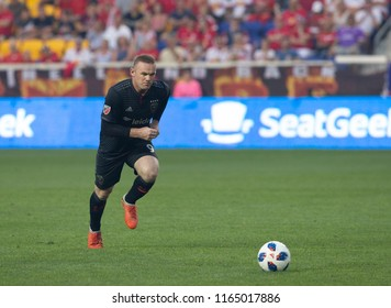 Harrison, NJ - August 26, 2018: Wayne Rooney (9) of D.C. United performs free kick during regular MLS game against Red Bulls at Red Bull Arena Red Bulls won 1 - 0