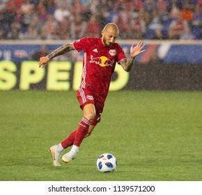 Harrison, NJ - July 21, 2018: Daniel Royer (77) of Red Bulls controls ball during regular MLS game against New England Revolution at Red bull Arena Red Bulls won 2 - 0