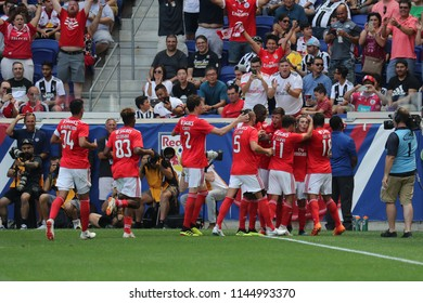 HARRISON, NJ - JULY 28, 2018: Team Benfica celebrates after Alex Grimaldo #3 scores a goal for Benfica against Juventus in the 2018 International Champions Cup game at Red Bull Stadium