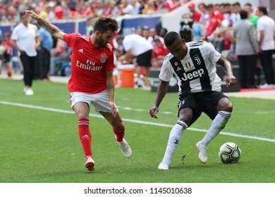 HARRISON, NJ - JULY 28, 2018: Alex Sandro of Juventus (R) and Rafa Silva of Benfica in action during the 2018 International Champions Cup game at Red Bull Stadium