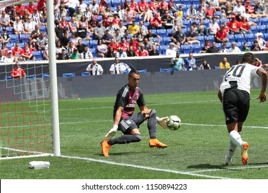 HARRISON, NJ - JULY 28, 2018: Goalkeeper Odisseas Vlachodimos #99 of Benfica saves during the 2018 International Champions Cup tournament soccer match against Juventus