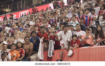 Harrison, NJ - JULY 31, 2014: Fans of FC Bayern Munich celebrate their team winning friendly match against CD Guadalajara Chivas at Red Bull Arena