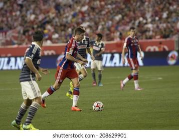 Harrison, NJ - JULY 31, 2014: Robert Lewandowski (9) of FC Bayern controls the ball during friendly match between CD Guadalajara Chivas and FC Bayern Munich at Red Bull Arena