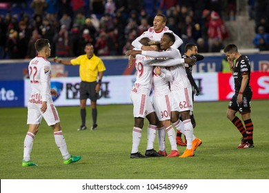 Harrison, NJ - Mar 13, 2018: Red Bulls team celebrates scoring goal by Marc Rzatkowski (90) during Scotiabank Concacaf Champions League quarterfinal 2nd leg game against Club Tijuana at Red Bull Arena