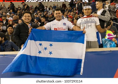 Harrison, NJ - March 1, 2018: Fans of CD Olimpia of Honduras attend 2018 CONCACAF Champions League round of 16 game against New York Red Bulls at Red Bull arena, Red Bulls won 2 - 0
