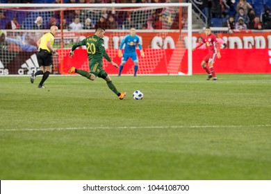 Harrison, NJ - March 10, 2018: David Guzman (20) of Portland Timbers kicks ball during regular MLS game against New York Red Bulls at Red Bull Arena Red Bulls won 4 - 0