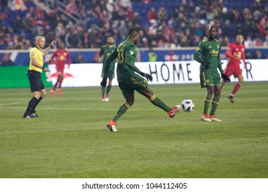 Harrison, NJ - March 10, 2018: Larrys Mabiala (33) of Portland Timbers controls ball during regular MLS game against New York Red Bulls at Red Bull Arena Red Bulls won 4 - 0