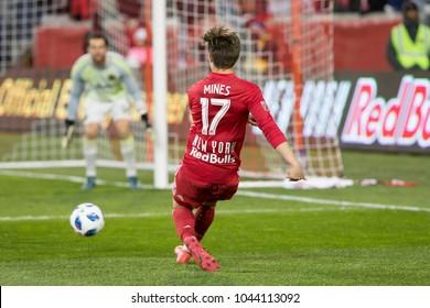 Harrison, NJ - March 10, 2018: Benjamin Mines (17) of Red Bulls kicks the ball during regular MLS game against Portland Timbers at Red Bull Arena Red Bulls won 4 - 0