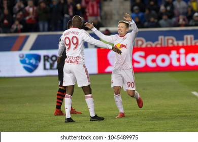 Harrison, NJ - March 13, 2018: Marc Rzatkowski (90) of Red Bulls celebrates scoring goal during Scotiabank Concacaf Champions League quarterfinal second leg game against Club Tijuana at Red Bull Arena